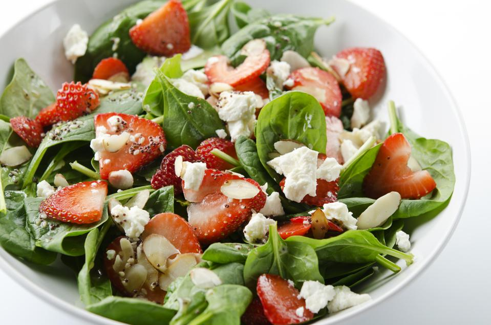 Green salad with strawberries and spinach