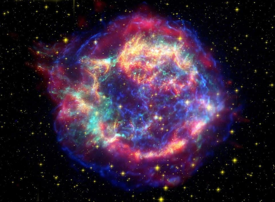 This false-color picture shows off the many sides of the supernova remnant Cassiopeia A, which is made up of images taken by three observatories, using three different wavebands of light.