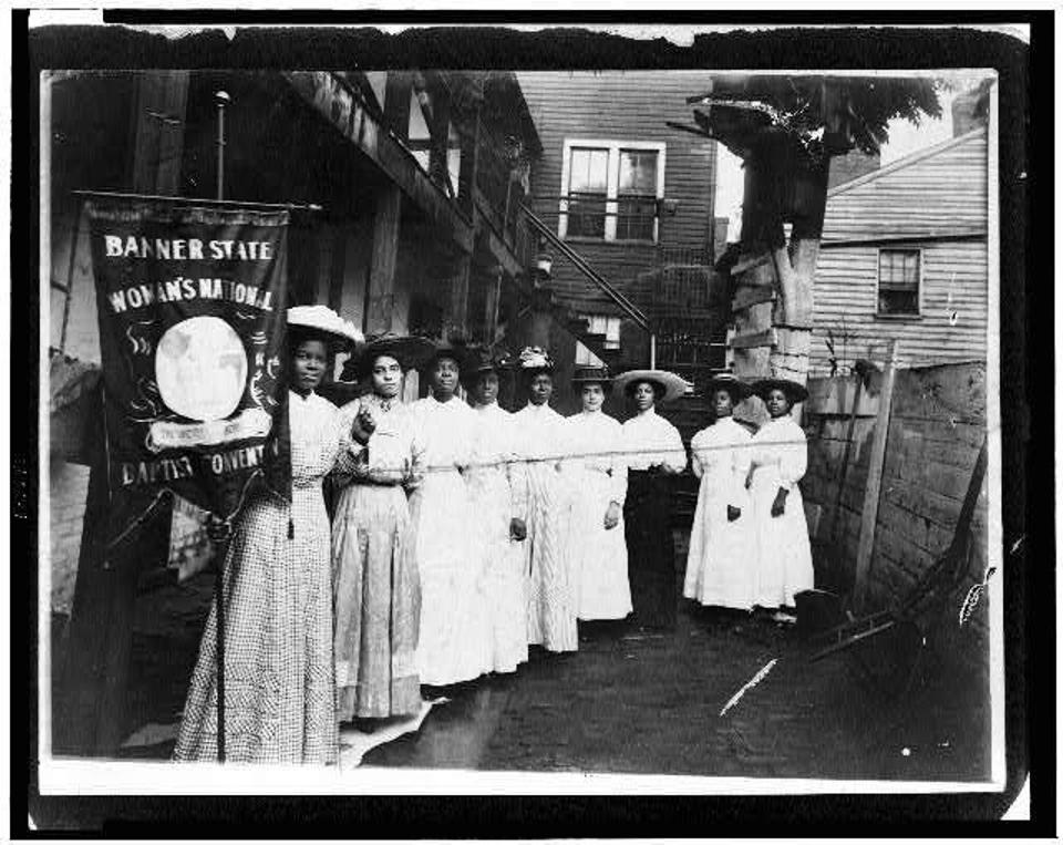 Black women suffragists, with Nanny Burroughs holding the banner