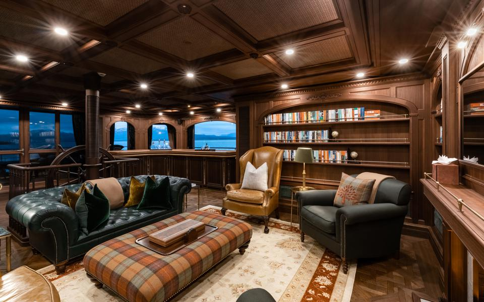 Library in the sky lounge on the Burgess charter explorer yacht Ragnar