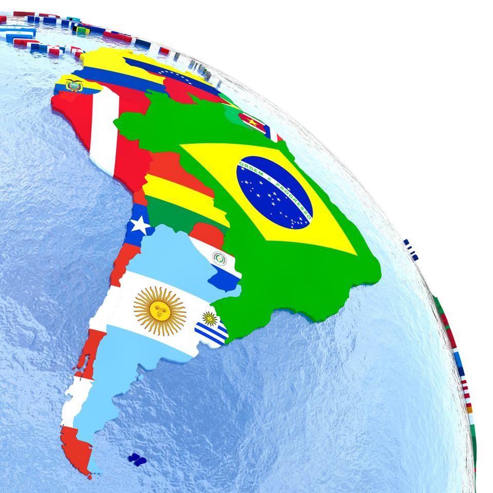 South America on political globe with flags