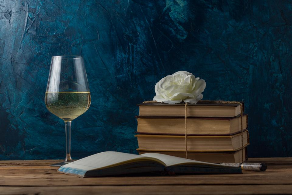 Glass with White Wine, Books Connected by a Juggle Rope, White Rosebud, An Open Book and Pen