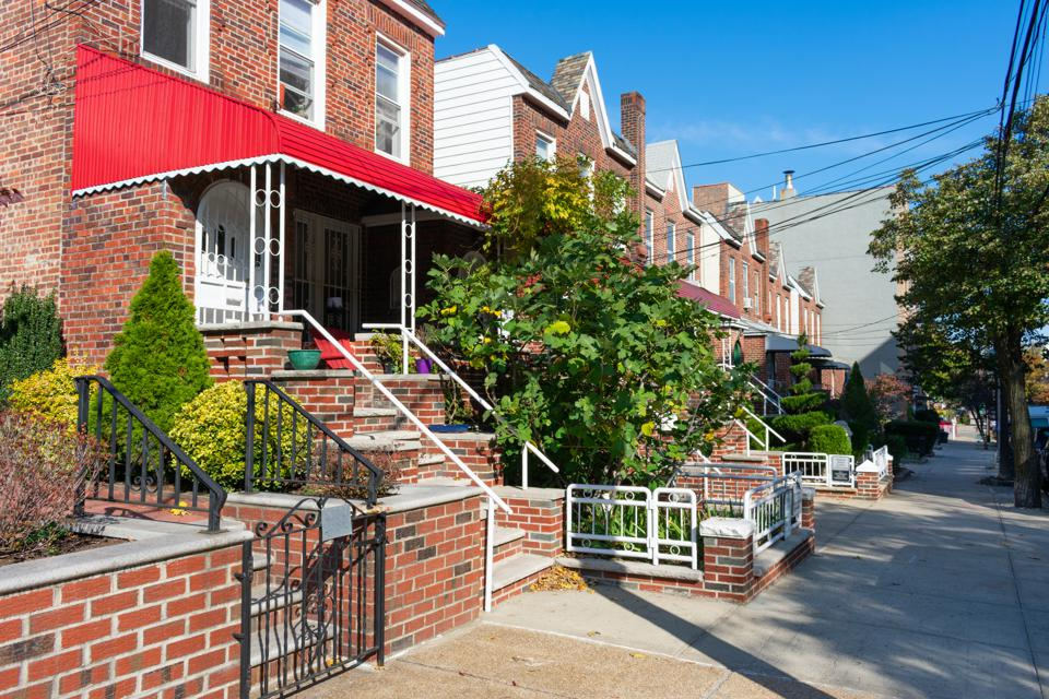 A Row of Old Brick Homes along the Sidewalk in Astoria Queens New York