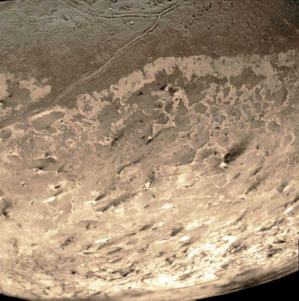 Triton's south polar terrain photographed by the Voyager 2 spacecraft.