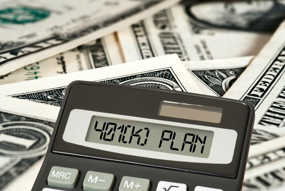 Dollar bills, calculator and 401 k Plan