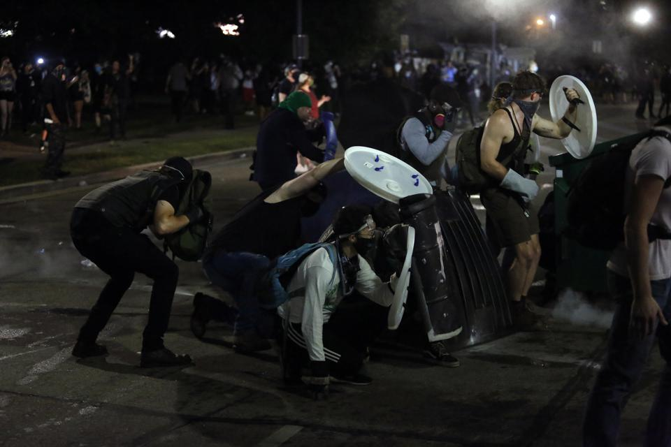 KENOSHA, WI - AUGUST 25: Demonstrators protest the police shoot