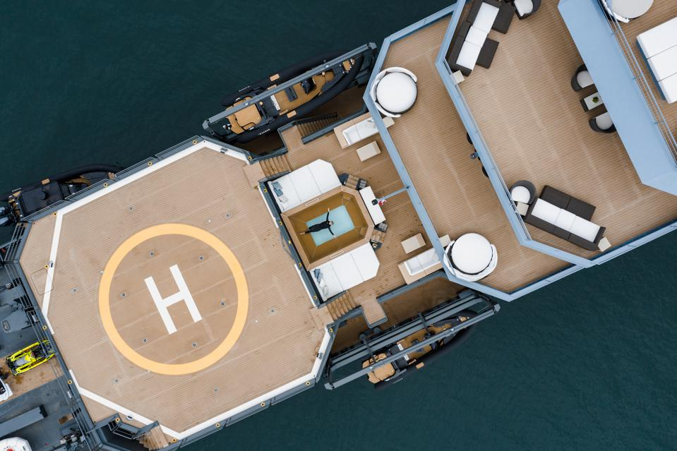A bird's eye view of the helipad and jacuzzi on the Ragnar charter explorer yacht