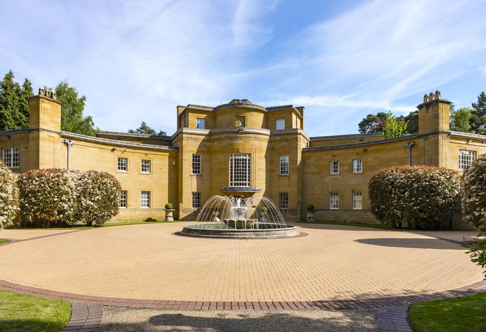 Hamstone House on St. George's Hill, Surrey, whose design is inspired by an Art Deco wristwatch, has listed for $21 million