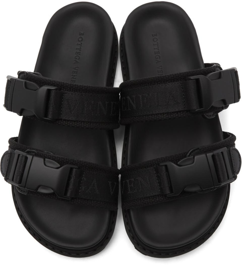 Buffed calfskin and wool canvas slip-on sandals in black. Open round toe. Adjustable logo-woven webbing straps with press-release fastening. Logo embossed at molded leather footbed. Tonal treaded rubber sole. Tonal hardware.