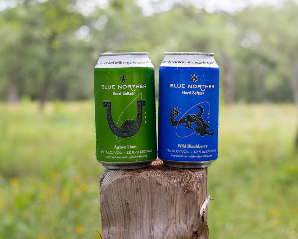 Blue Norther cans on a ranch fence post