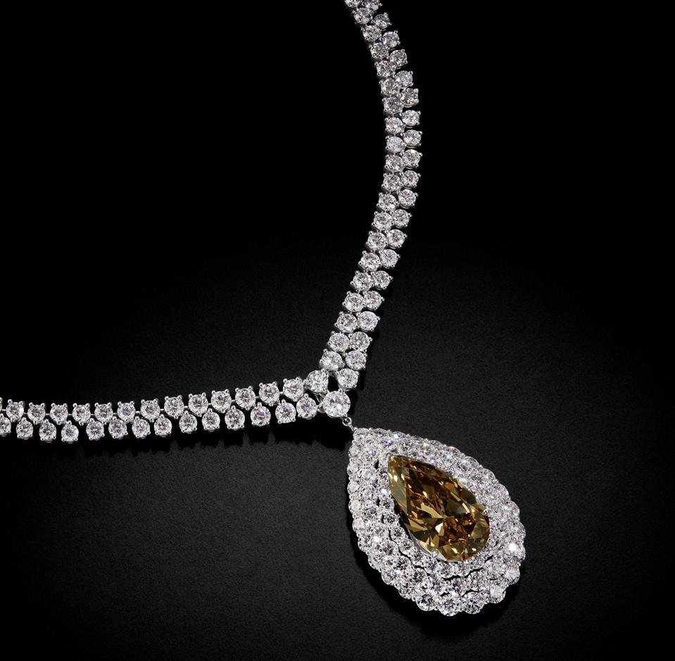 A diamond necklace by Graff, that features a 20.21-carat pear shaped yellow-brown diamond