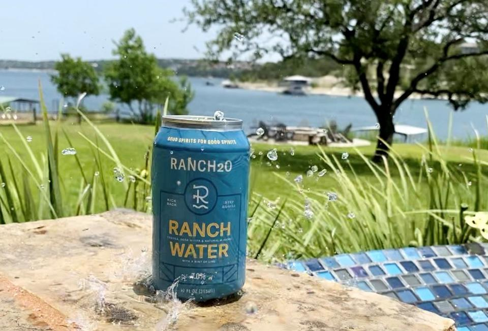 Can of RancH2O ranch water with lake in the background