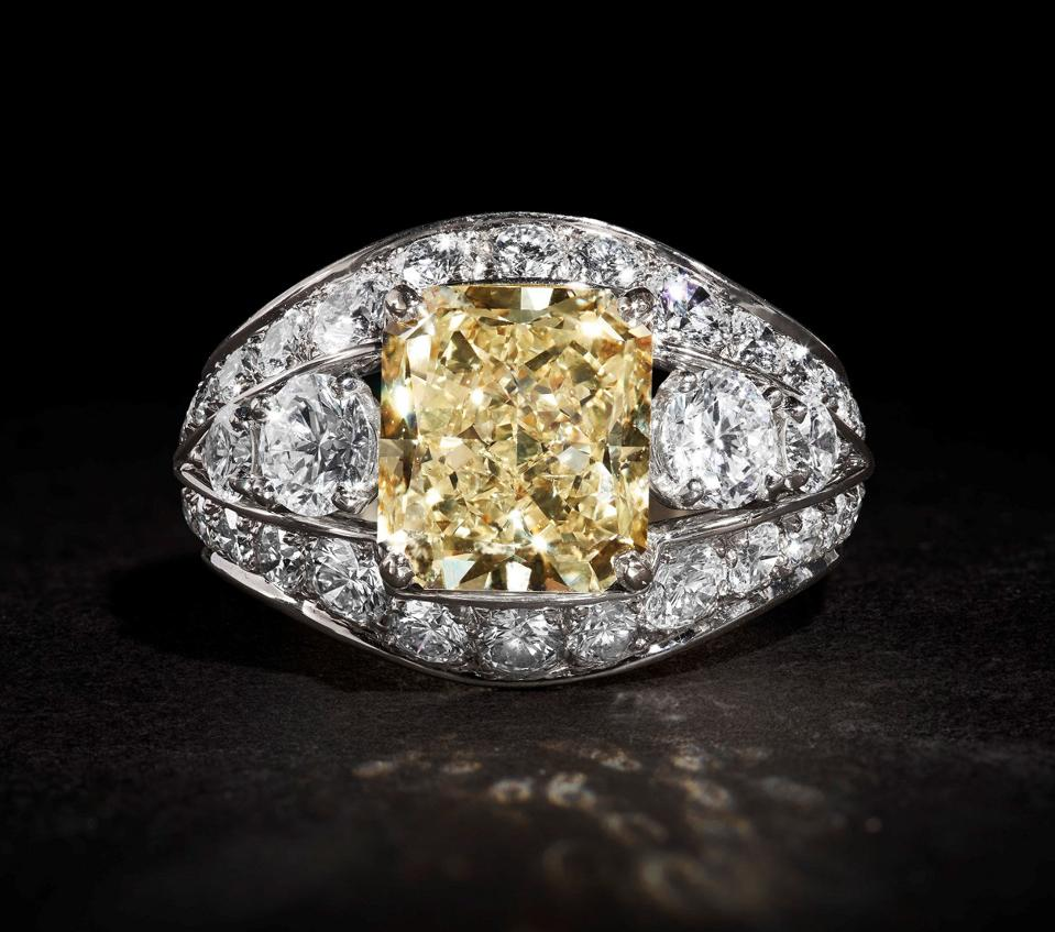 A Graff 18k white and yellow gold ring centered with a 5.18-carat fancy yellow diamond