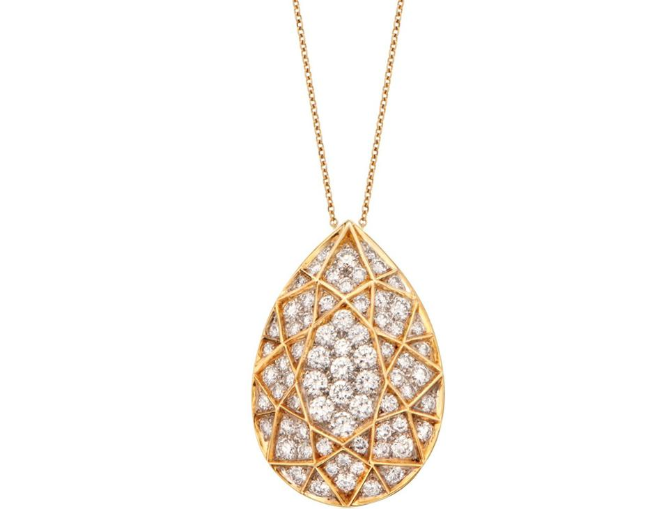 A Tiffany & Co. 18k yellow gold and diamond pendant necklace designed by Else Peretti