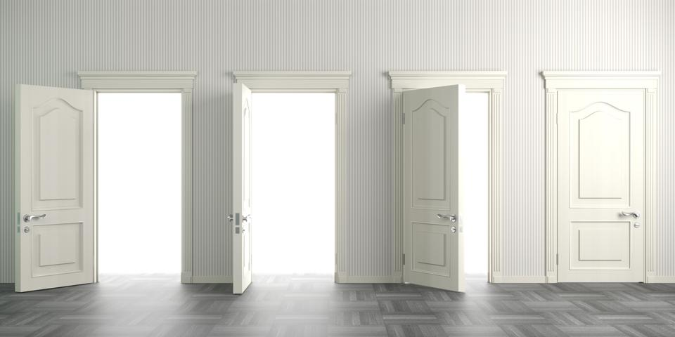 White wall with four white doors. Might be a stairway to heaven on the other side.