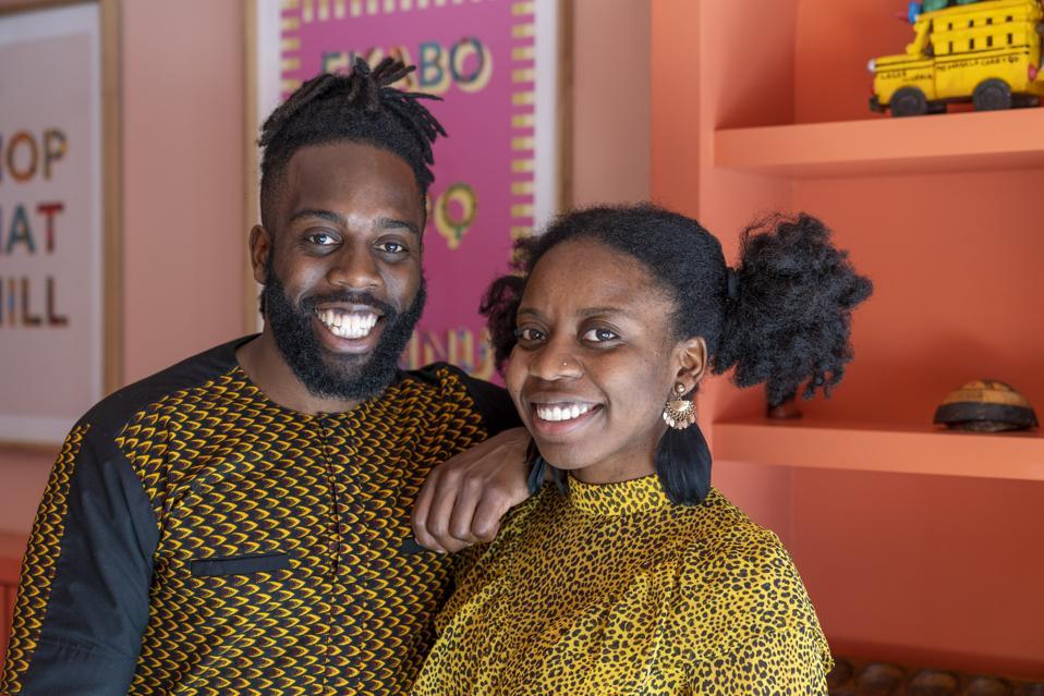 Emeka and Ifeyinwa smile in their restaurant