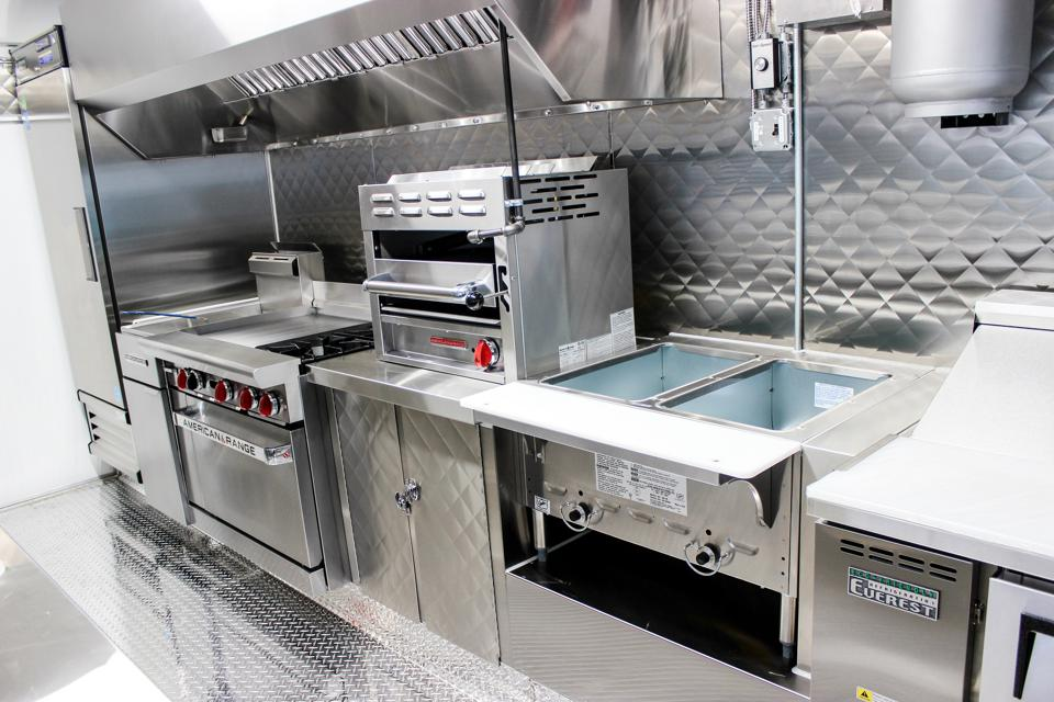 The interior preparation area of a food trailer.
