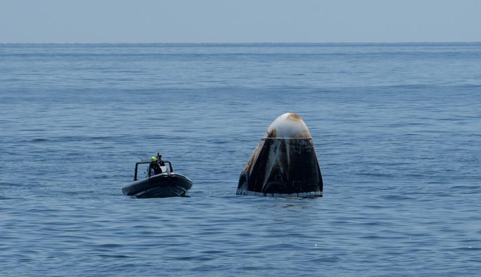 The scorched SpaceX Crew Dragon spacecraft from Demo-2 is shown here.