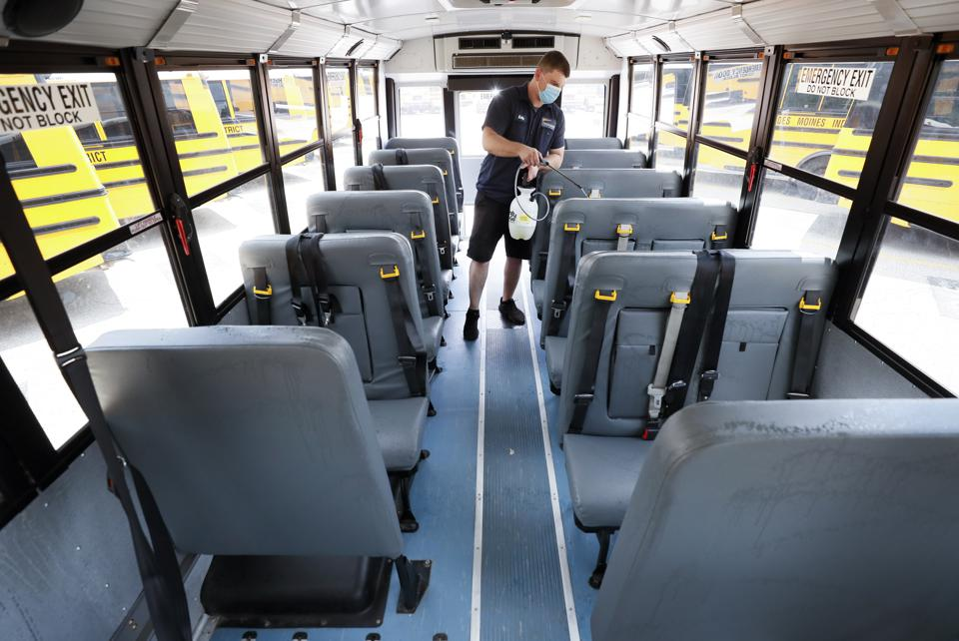 Virus Outbreak Iowa School Bus Cleaning