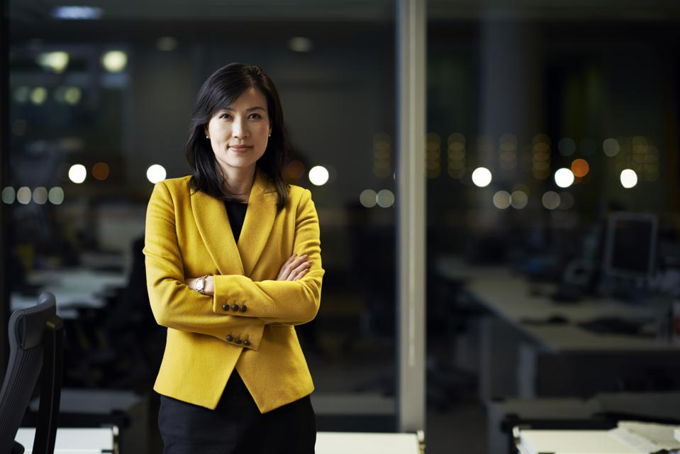 Woman standing in office at night