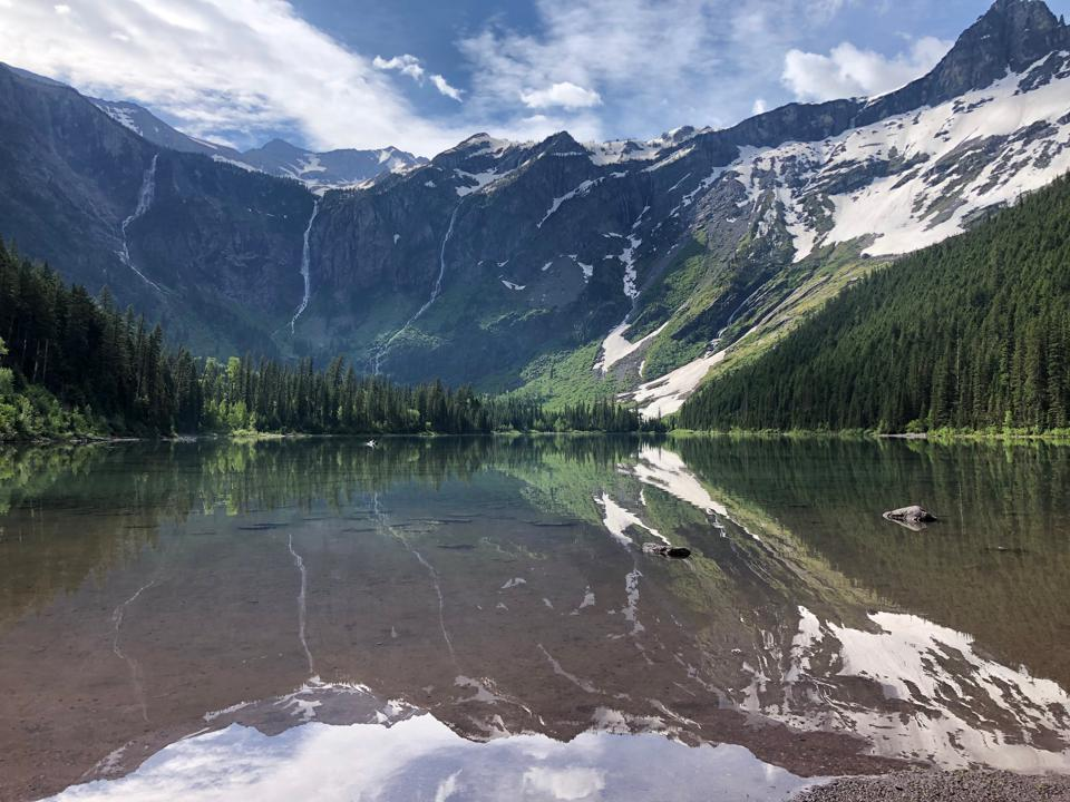 Mirror-clear waters of Avalanche Lake, Glacier National Park, Montana.