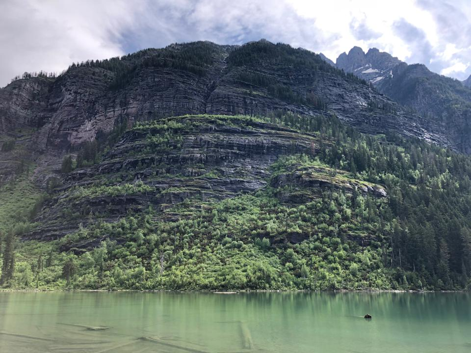 Craggy, striated mountain face on Avalanche Lake, Glacier National Park, Montana.