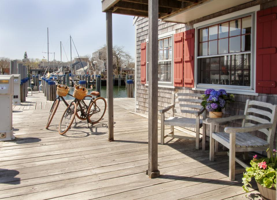 A shingled cottage overlooking the harbor