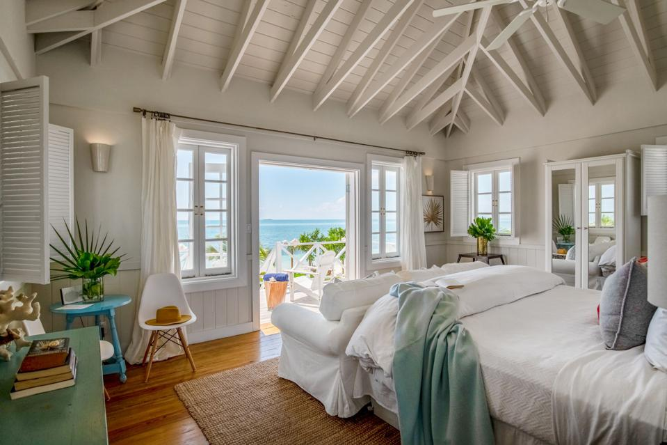 A whitewashed interior of a cottage overlooking the water