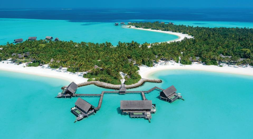 Overwater bungalows and turquoise water