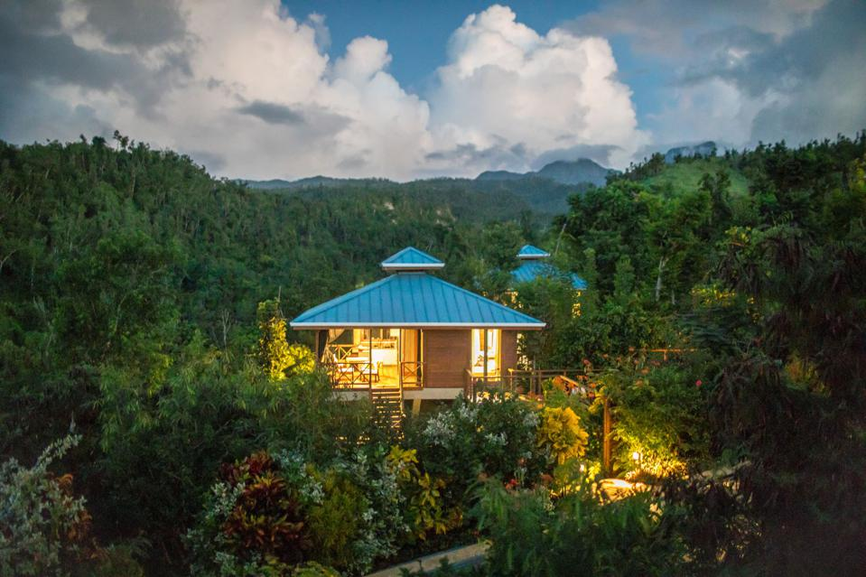 A hilltop villa in the midst of a lush rainforest