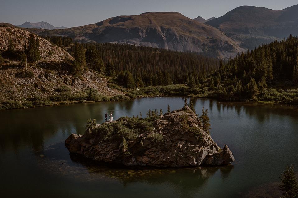 Mariah Jensen and Matt Taormina on a mountain lake island in Colorado.