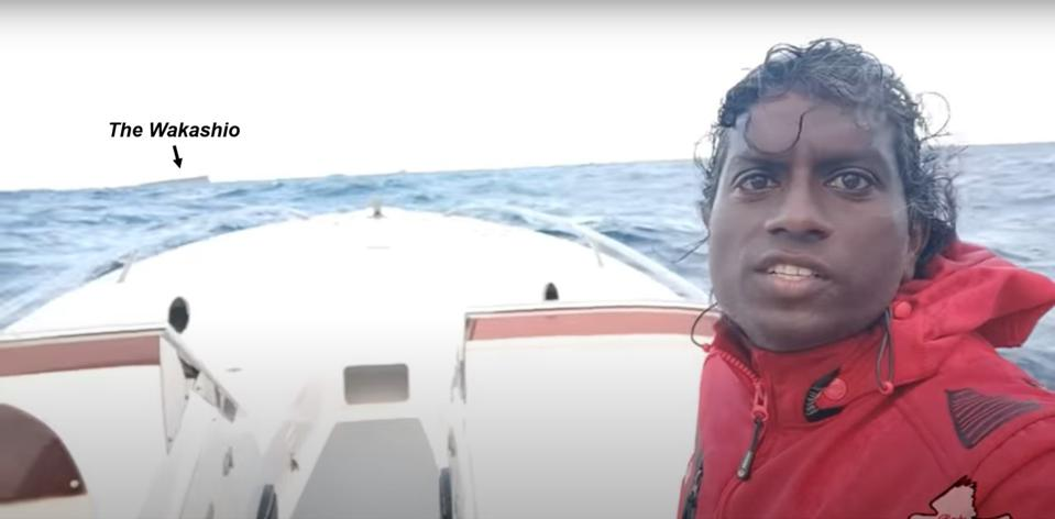 19 August 2020: local journalist Reuben Pillay rushes out to catch the Wakashio as it is towed off the coral reefs of Mauritius earlier on 19 August