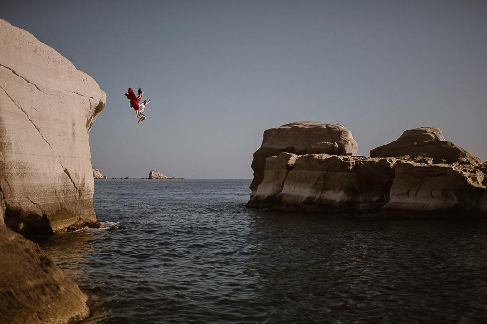 A newly wedded couple taking another leap in Greece.