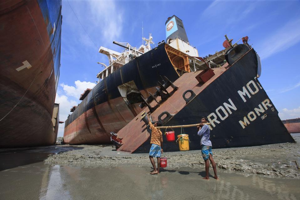 Ship breaking laborers working at Sitakundo ship breaking...