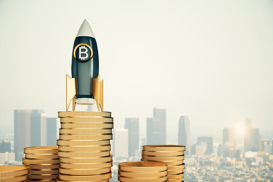 Futuristic bitcoin rocket on golden coins