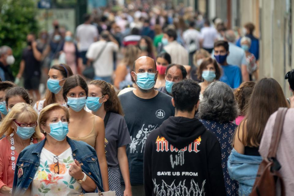 People wear masks in Spain as Covid cases rise again to an EU high amid more travel bans