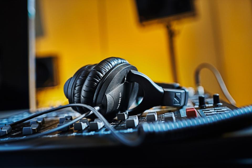 Pair of Sennheiser HD280 Pro on a mixing desk