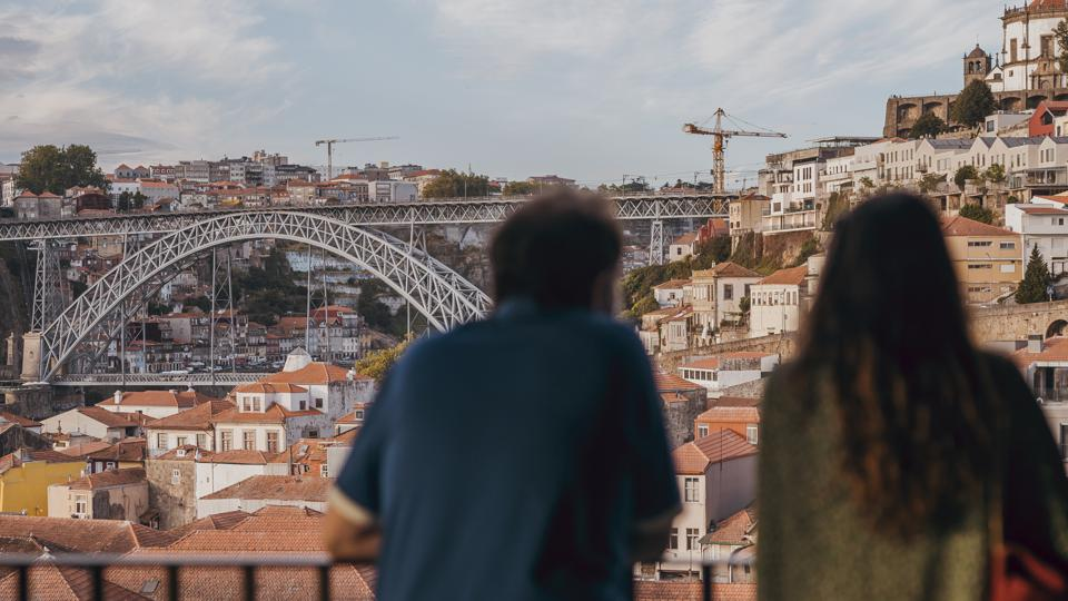 tourists looking at porto from world of wine
