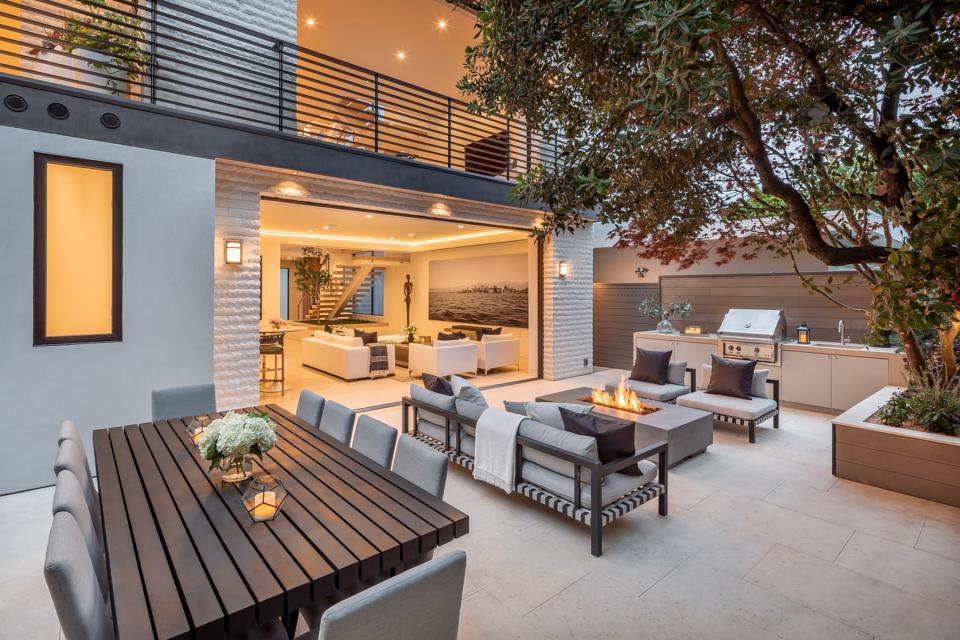 Backyard with outdoor kitchen, seating