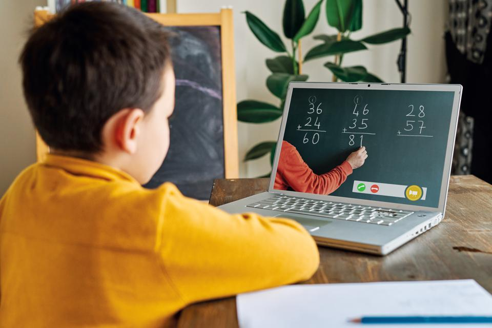 Child learning mathematics from computer.
