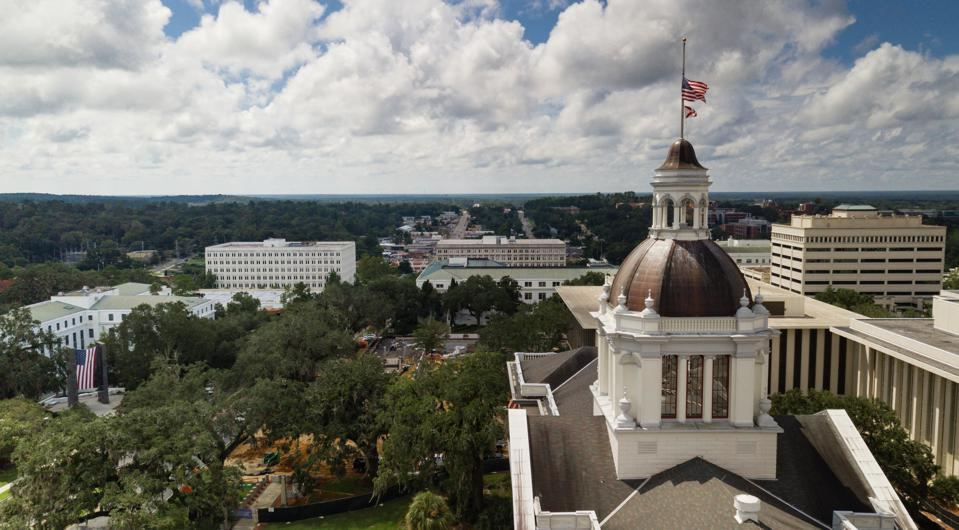 Flags Blow Atop The Capital Dome in Tallahassee Florida