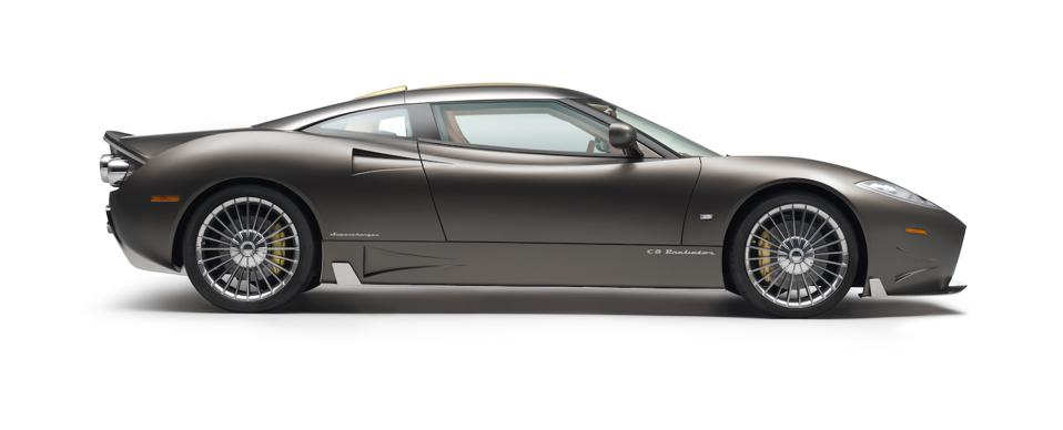 The profile of a matte grey supercar.
