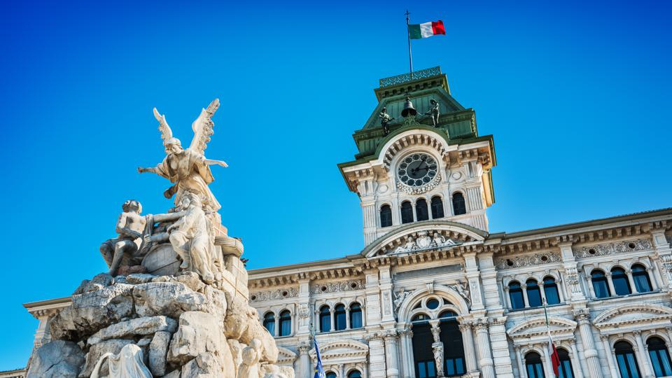 Fountain and Town Hall in Trieste, Italy