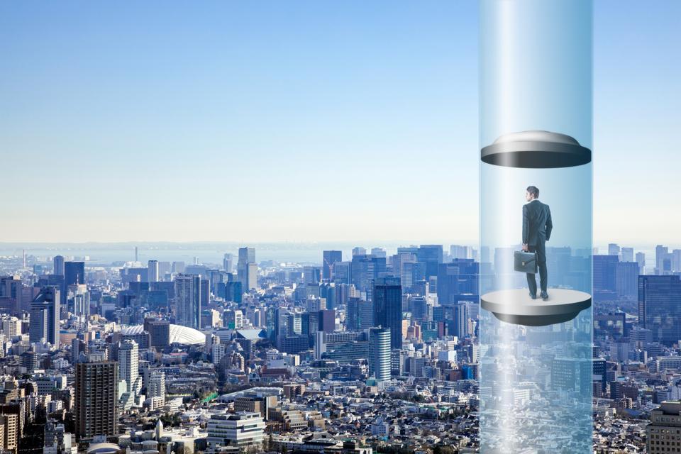 modern city skyline and futuristic elevator. space elevator concept.