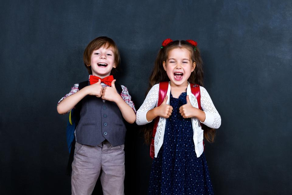 Schoolgirl and schoolboy in classroom at elementary school