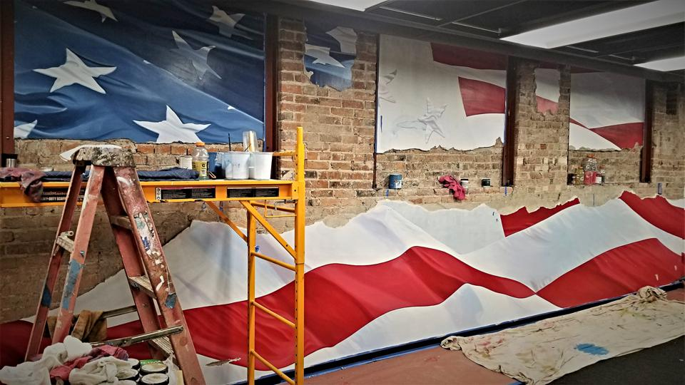 An American Flag mural created by leaders at Emergent Campus to inspire workers and demonstrate American pride