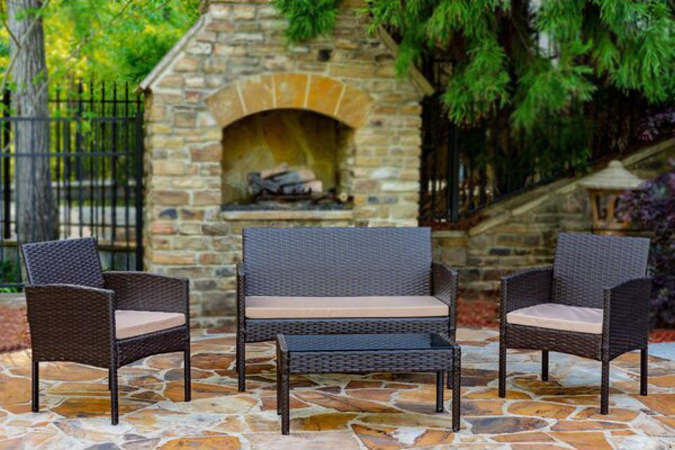 World Menagerie Tessio 4 Piece Rattan Seating Group with Cushions