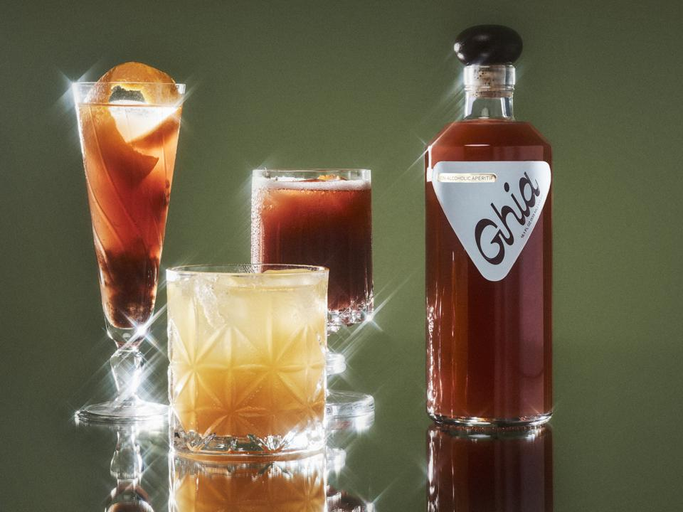 Ghia bottle with cocktails in glass