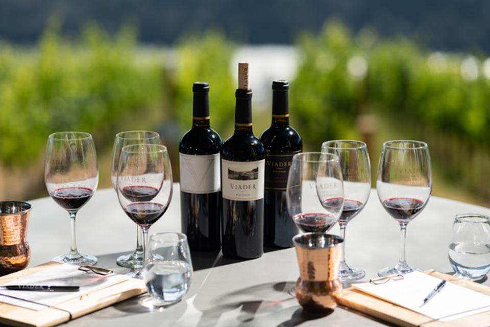 A flight of VIADER wines is poured on the terrace of their Howell Mountain tasting room.