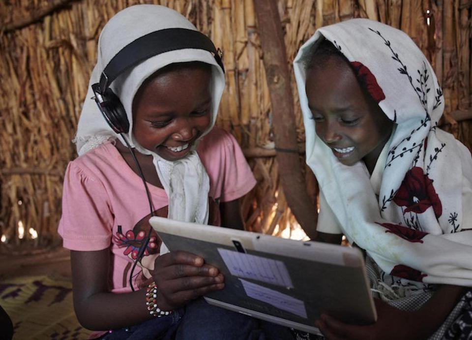 Children work together, using their tablet, at the UNICEF supported Debate e-Learning Center in a village on the outskirts of Kassala, the capital of the state of Kassala in Eastern Sudan.